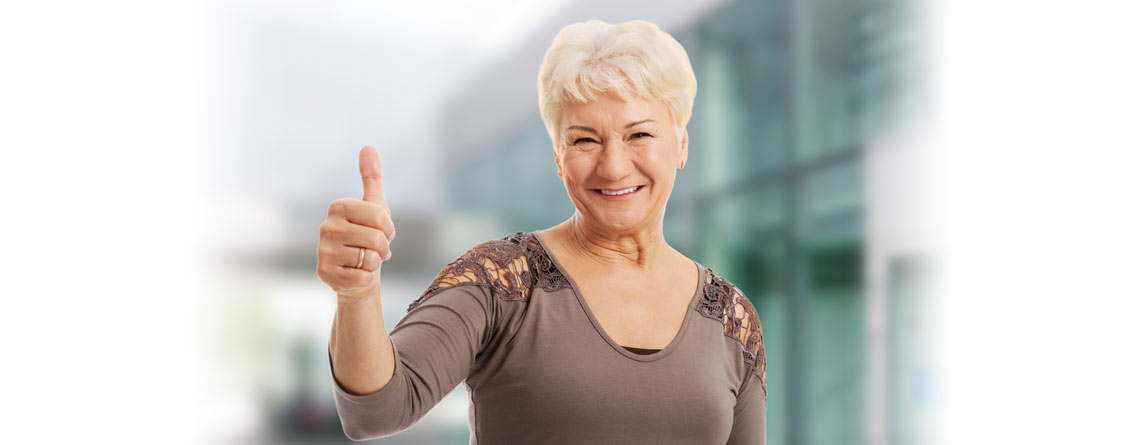 Woman giving a thumbs up sign